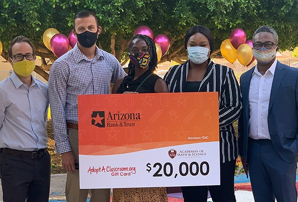 Arizona State Bank employees posing for a photo with $20,000 check presented to Adopt A Classroom